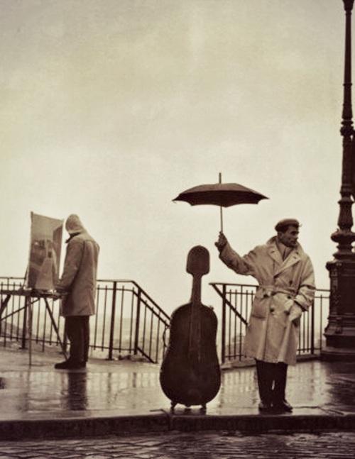 Doisneau Robert Musican in the Rain